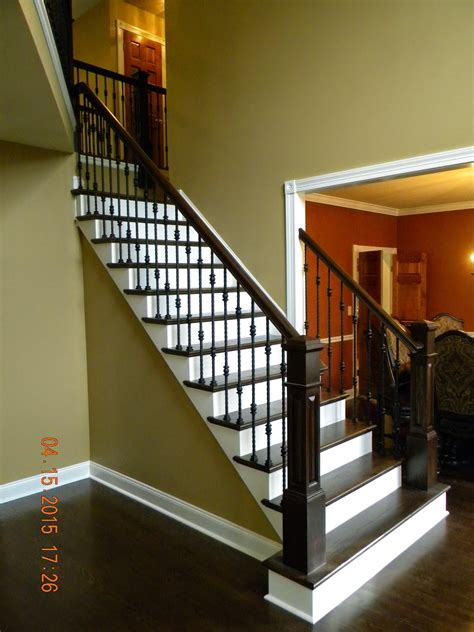 Wood Stairs and Rails and Iron Balusters: Oak Handrail and