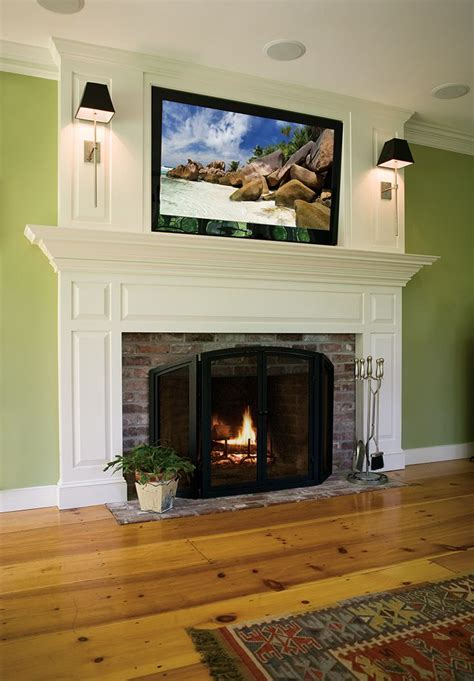 A traditional custom fireplace mantel with flat screen tv