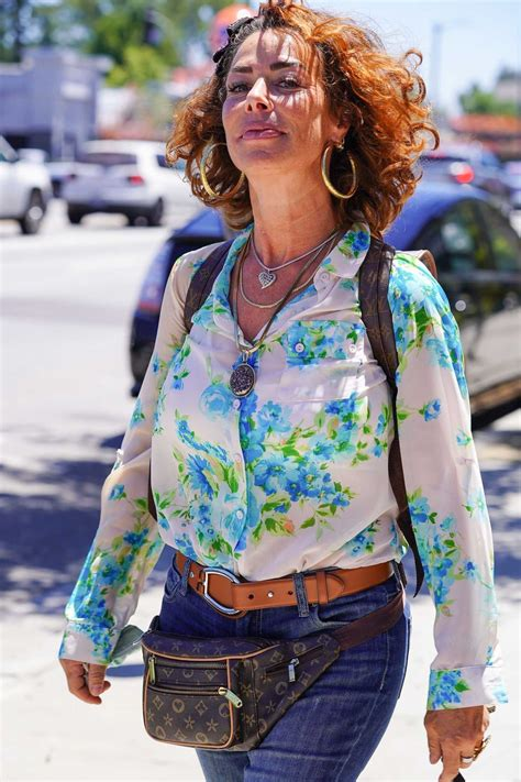 Claudia Wells in a White Floral Blouse Celebrates the 35th